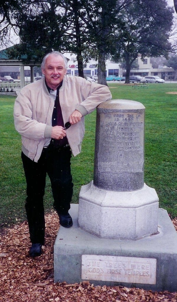 Eric F. James, standing beside the public monument to Drury Woodson James, founder of Paso Robles, California. The monument stands in the two blocks of public park Drury donated to the city