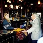 Jesse's great grandson, Judge James R. Ross, sips a glass of wine at the bar his great-grandfather once drank at.
